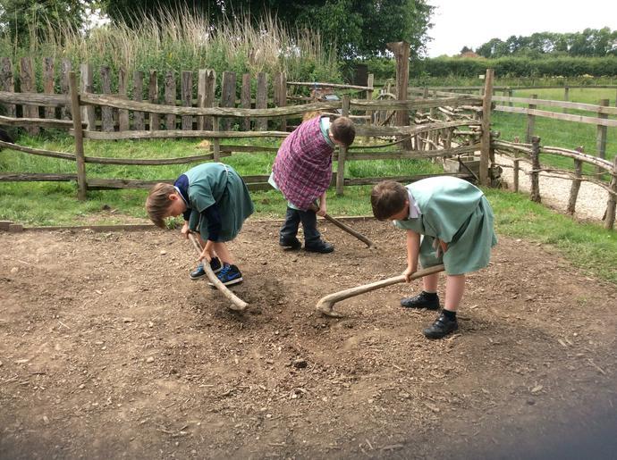 Boys tilling the land.
