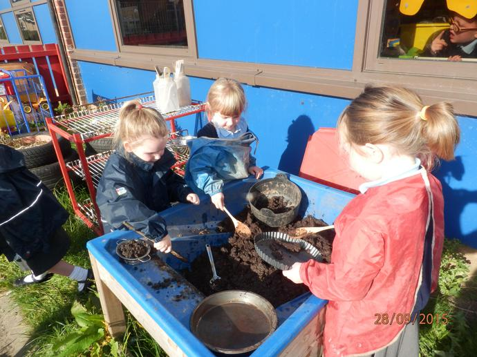 Playing in the mud kitchen!