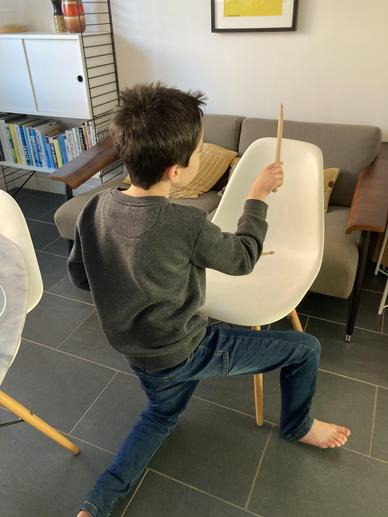 A pupil chair drumming at home!