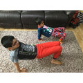 Kanav doing Yoga with his younger Brother