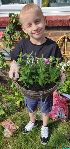 Tymon with his plants ready for his investigation