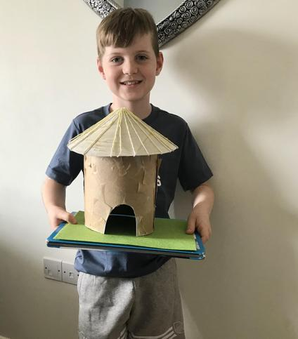 Archie's Stone Age House using recycled cereal box