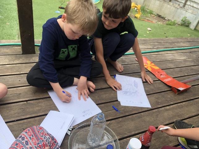 Jack and family write up their volcano experiment.