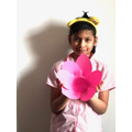 Akshara making paper decorations