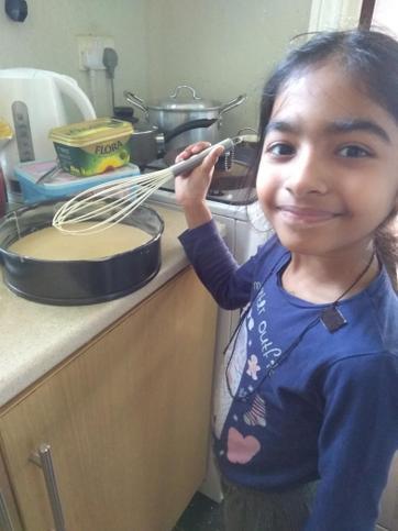 Nicole helping Mum bake.