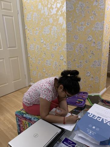 Iyra working hard at home.