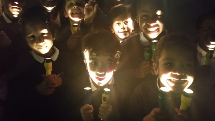 Torches in the dark at After School Club