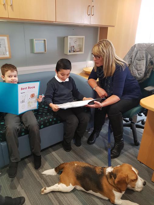 Reading with Nurture dog Charlie