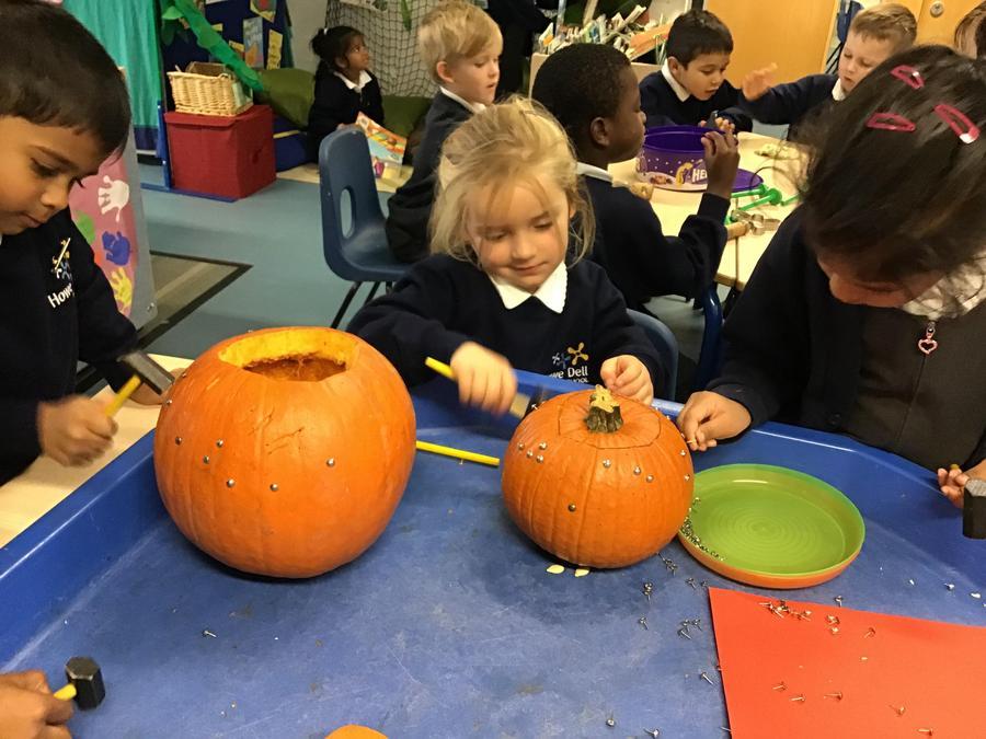 Hammering nails into pumpkins