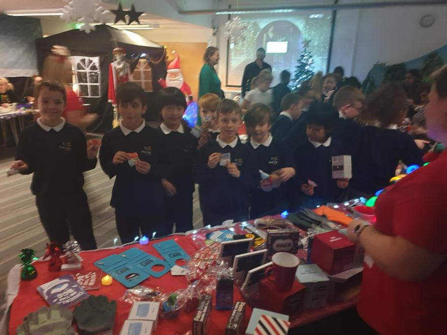 The PSA 'elves' help wrap and decorate the gifts
