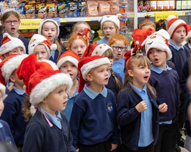 Choir sing carols at Tesco