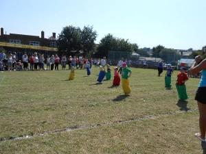 Reception children competing in the sack race
