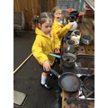 We have fun in the mud kitchen.