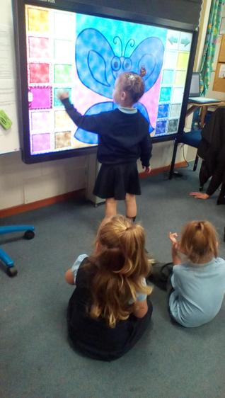 Exploring colour, shape and pattern on the Smartboard.