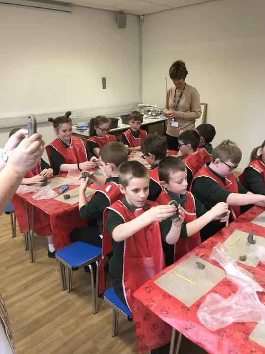 Making clay Shabtis.