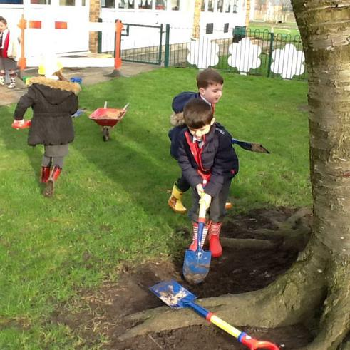 Digging for mud to make a house for the dinosaur!