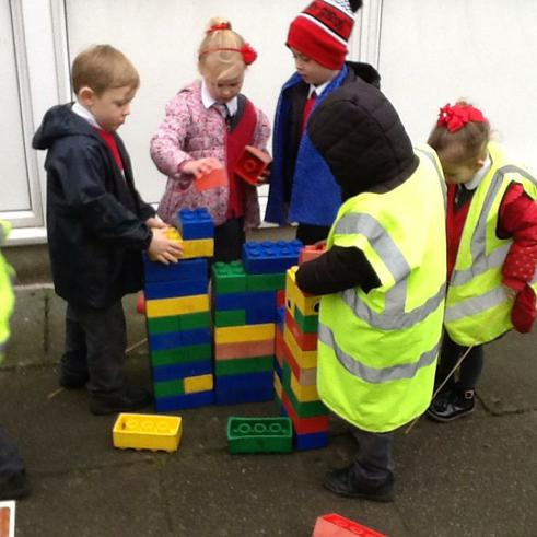 Using the blocks to build a house