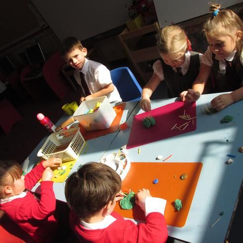 Exploring the play dough table.