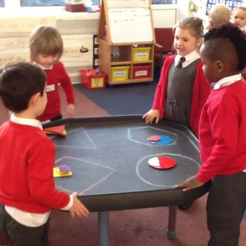Sorting shapes in the tuff tray