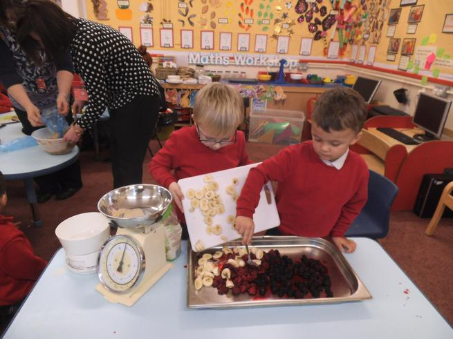 Mmmm! Lovely fruit for our Gruffalo crumble.