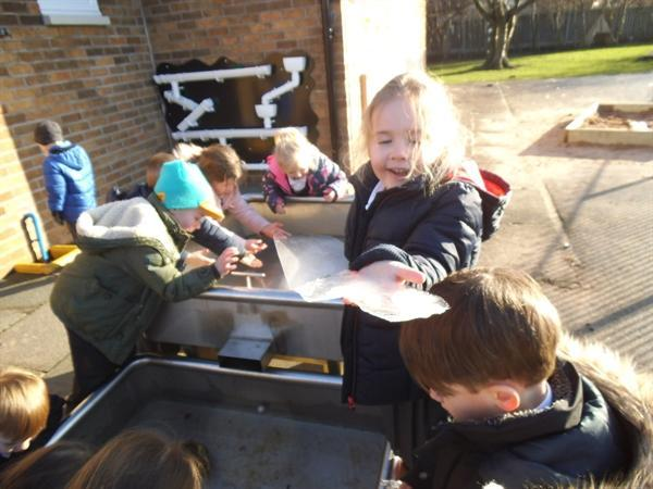Look at the water in our water tray! It is now ice