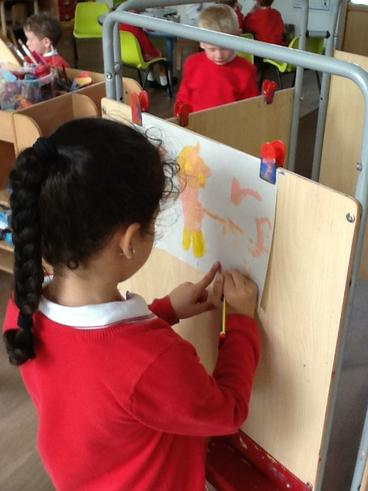 Painting and labelling our pictures