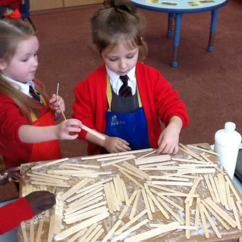 Making a house of sticks together