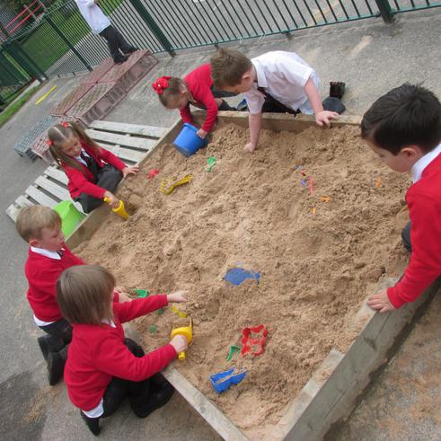 We have been outside exploring in the sand area.