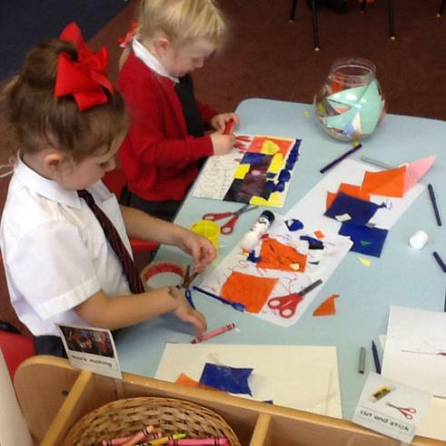 Cutting and sticking for our shape collage picture