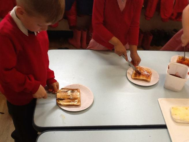 Cutting our jam toast in half