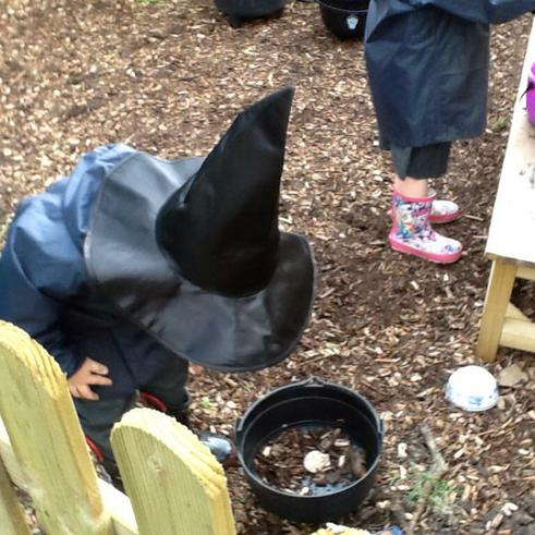 Making potions in the mud kitchen