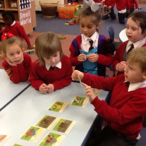 Retelling the story using story cards.