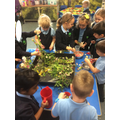 Making potions with flowers, water and sand