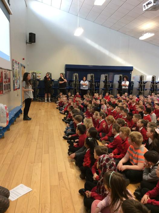 Katie introducing herself to the school.