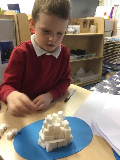 Using sugar cubes to build an Igloo