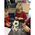 Working together to build an igloo with sugar cube
