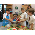 All hands on deck to mix the ingredients together.