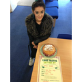 A year 11 student with her cake.
