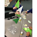 We made our own Christmas trees using shapes