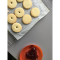 Finally we spread and squished the jam between the biscuits.