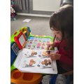 Layla used real coins for her maths work.