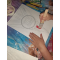 Rose is painting a VE day banner.