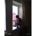 Daniel has painted a Rainbow on the window.