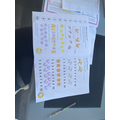 Ralph has been busy completing a maths work book.