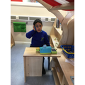 Sudais taking orders at the shop!