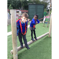 Isaac and Almas trying out the obstacle course.