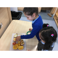 Sahar and Manha investigating fruit.