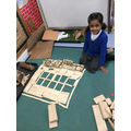 Rafia showing us her wooden house.