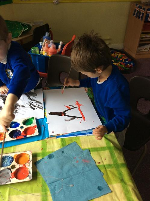 We enjoyed painting a volcano erupting.
