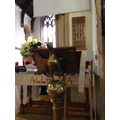The lectern and hymn numbers board.
